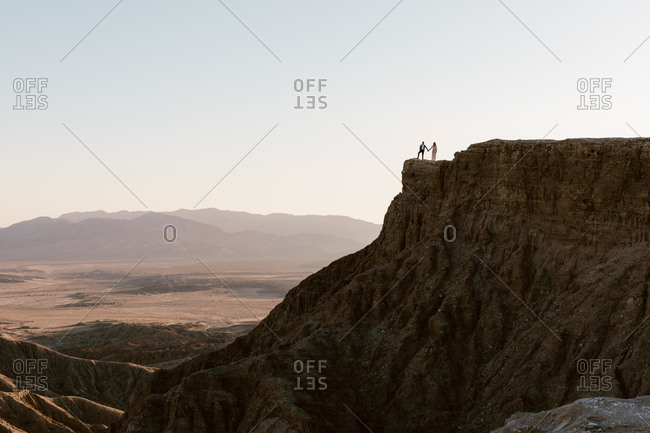Couple holding hands standing on Fonts Point overlook in the desert