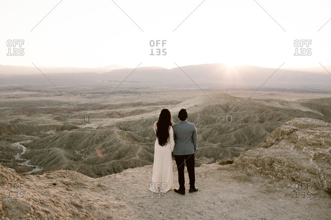 Man and woman looking out across a desert vista