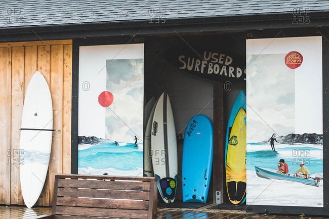 Tofino, Vancouver Island, Canada - October 7, 2019: Surfboard shop exterior with used boards on display