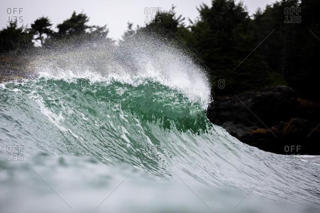 Cresting waves splashing in the ocean