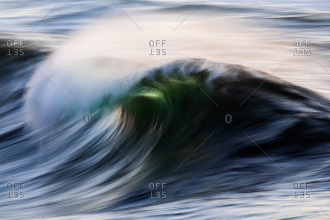 Blurred view of splashing wave in the ocean