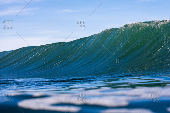 Large wave about to crest in the ocean