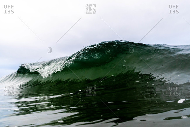 Curling green wave off the coast of Tofino