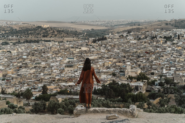 Back view of woman enjoying city view in the evening- Fez- Morocco