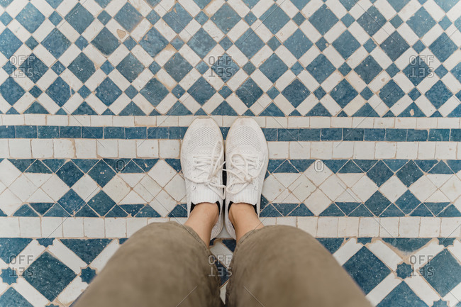 Woman's feet standing on traditionally tiled floor- Fez- Morocco
