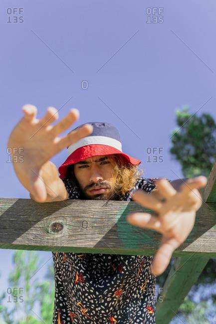Portrait of bearded young man wearing cap
