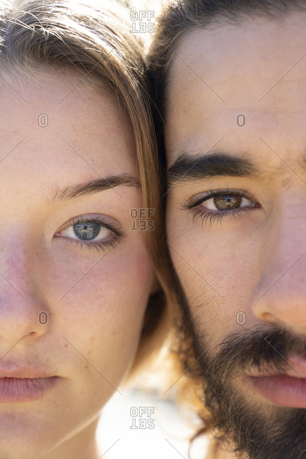 Young couple head to head- close-up