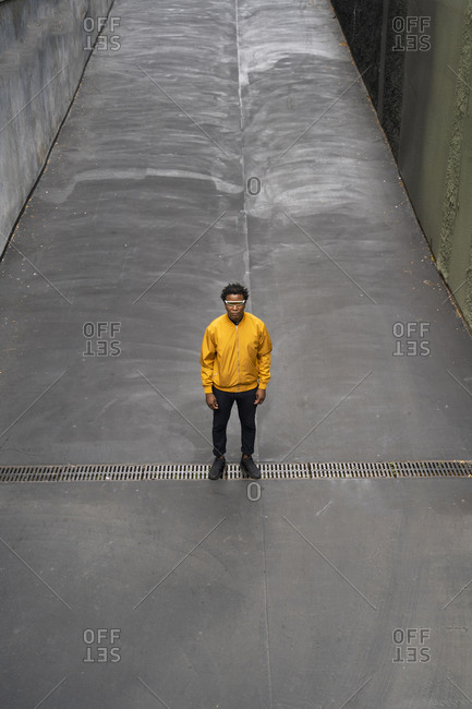 Mature man wearing yellow jacket and standing on lane