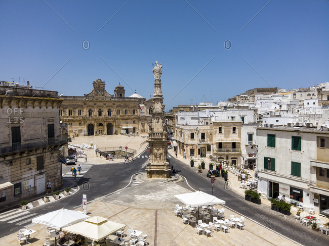 June 9, 2019: Italy- Province of Brindisi- Osuna- Clear sky over town square and Spire of Santorin
