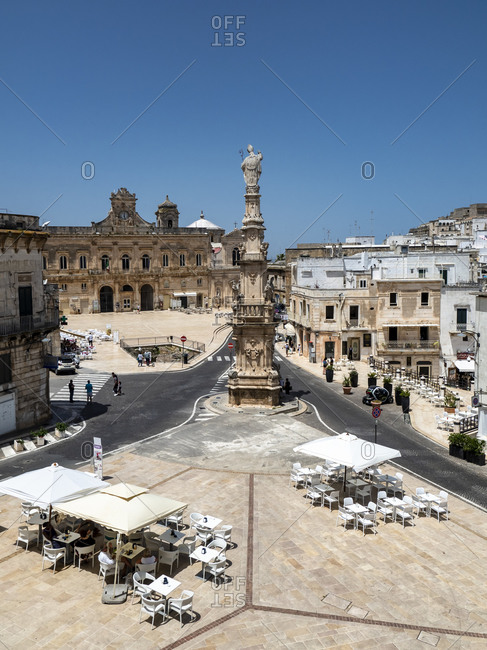 June 9, 2019: Italy- Province of Brindisi- Osuna- Clear sky over town square and Spire of