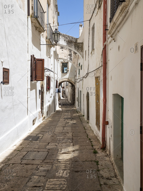 June 9, 2019: Italy- Province of Brindisi- Osuna- Empty alley between white-colored houses