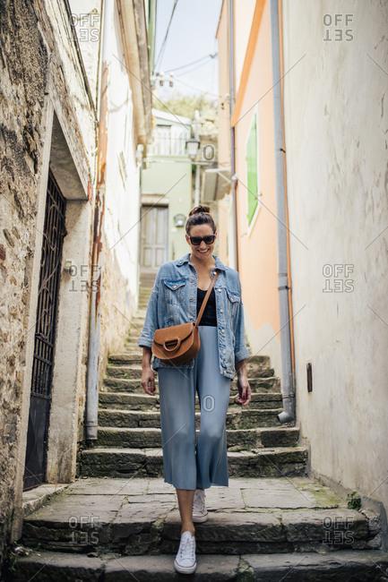 Woman walking in narrow lane- Piran- Slovenia