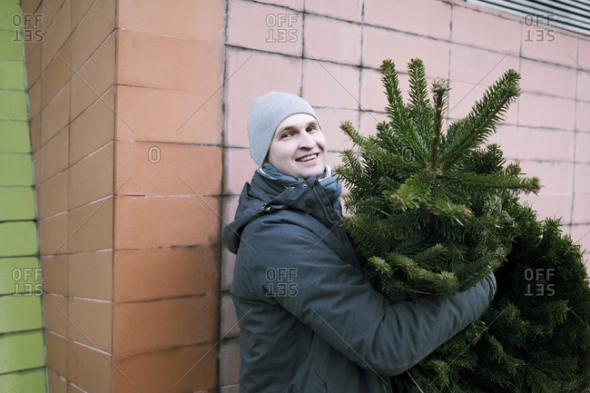 Smiling man with fir tree