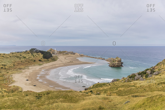 New Zealand- Wellington Region- Castlepoint- Deliverance Cove with clear line of horizon over Pacific Ocean