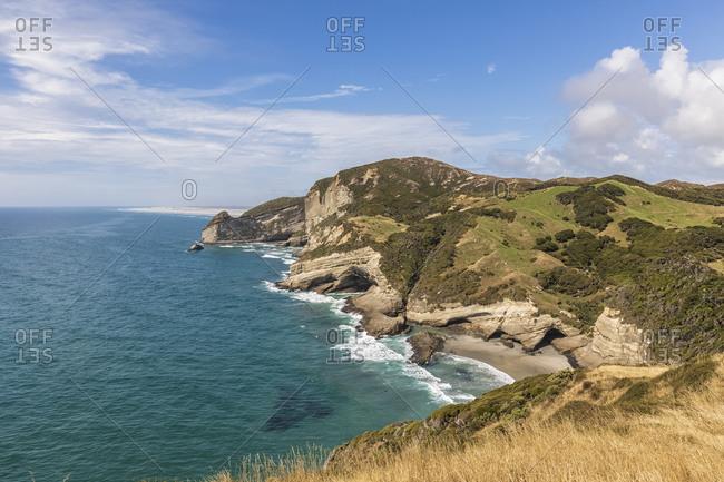New Zealand- Cliffs of Cape Farewell headland on sunny day