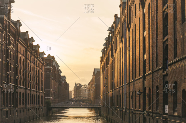 Germany- Hamburg- Speicherstadt- Old warehouses and canal in morning light