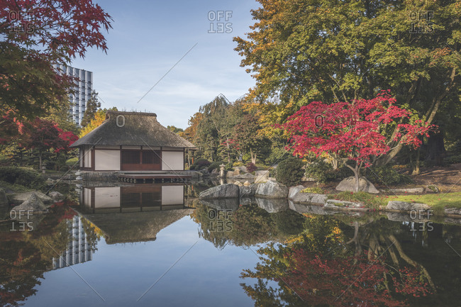 Germany- Hamburg- Shiny pond and Japanese teahouse in Planten un Blomen park
