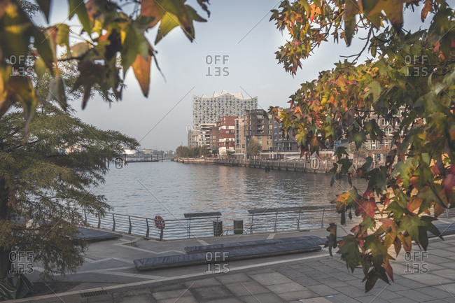 Germany- Hamburg- Marco Polo Terraces in autumn with Elbe river and Elbphilharmonie in background