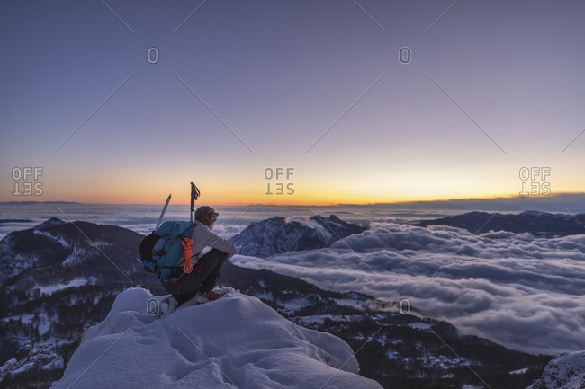 Mountaineer on the mountain summit during twilight- Orobie Alps- Lecco- Italy