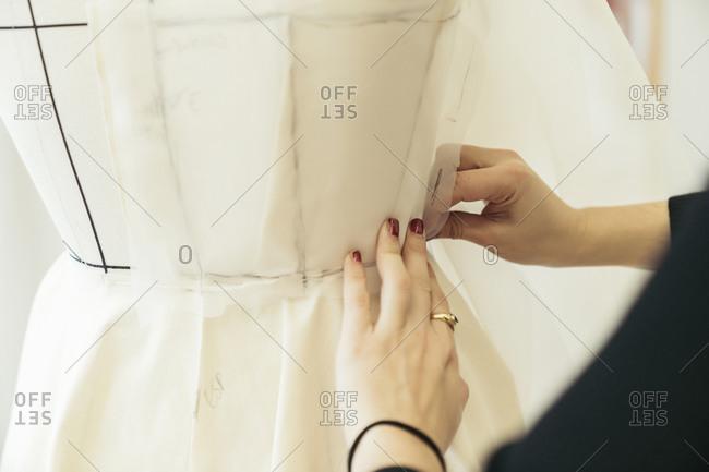 Fashion designer's hands at work