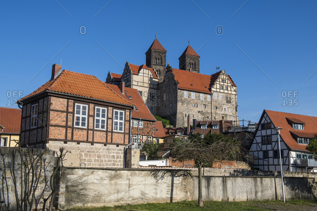 Germany- Saxony-Anhalt- Quedlinburg- Low angle view of Quedlinburg Abbey and surrounding half-timbered houses