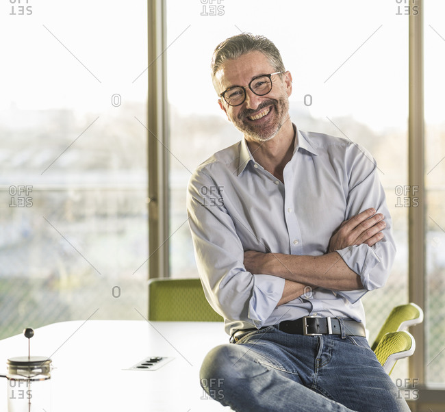 Portrait of a happy mature businessman in office