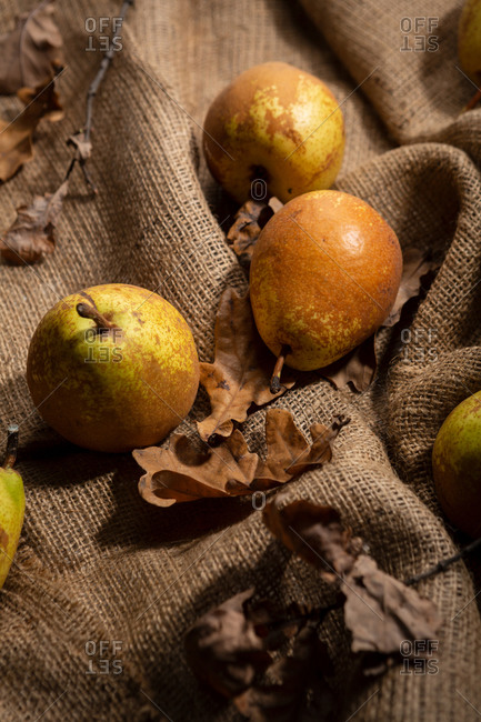 Yellow pears on rustic cloth