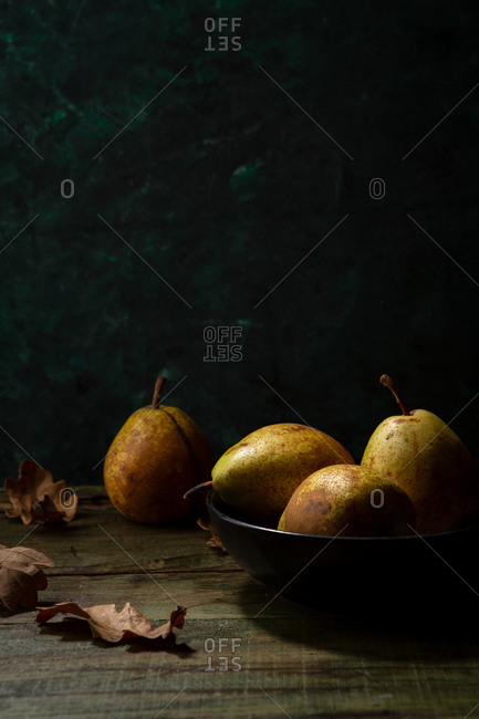 Yellow pears in black bowl