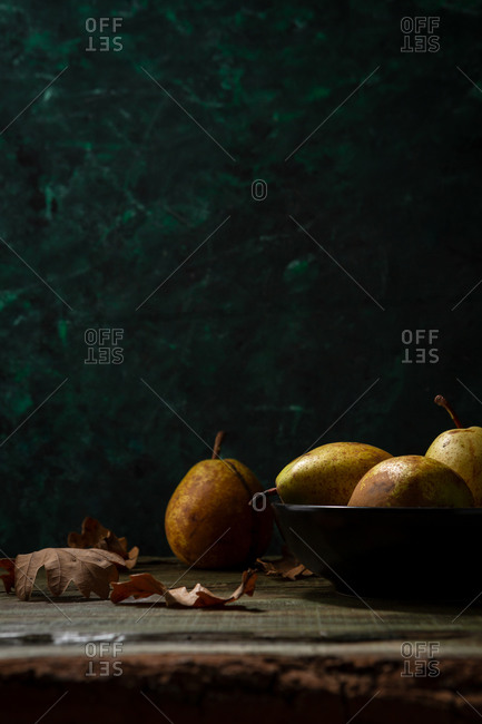 Yellow pears and dry leaves