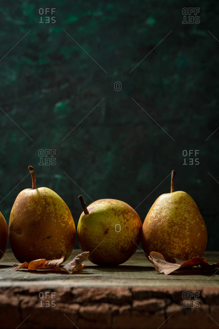 Fresh pears arranged on  wooden table