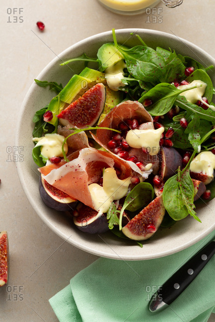 Close up of prosciutto salad with figs