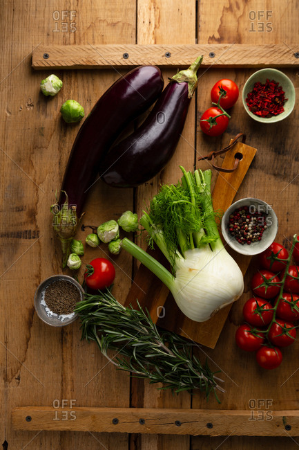 Variety of fresh vegetables on wooden surface