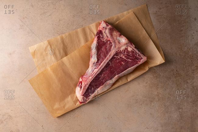prime beef steak on light surface