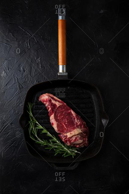 Fresh beef being prepared on black background