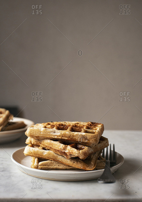 Square Waffles piled on a plate