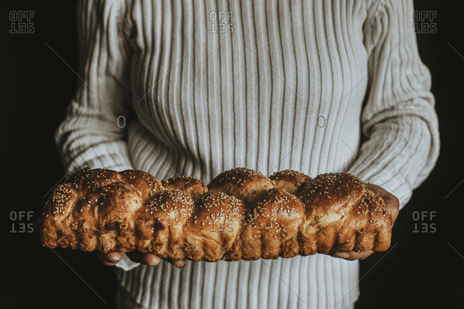 A Woman Holds Homemade Braided Bread