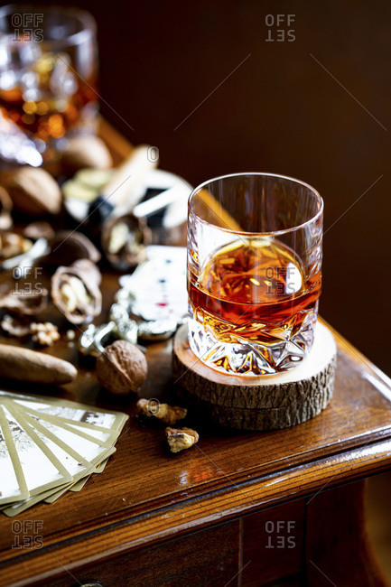 Alcohol and Cigar with nuts, vintage playing cards.