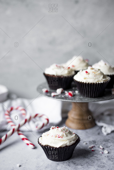 Peppermint Chocolate Cupcakes With A White Chocolate Buttercream Frosting Sprinkled With Crushed Candy Canes