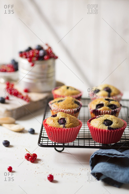 Cupcakes with red fruit on marble table