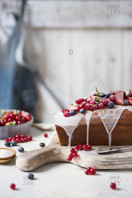 Loaf cake with red berries on the table