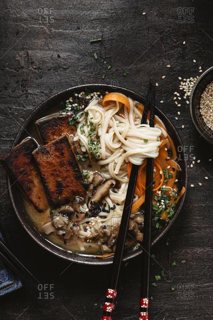 Vegan soup into a dark bowl