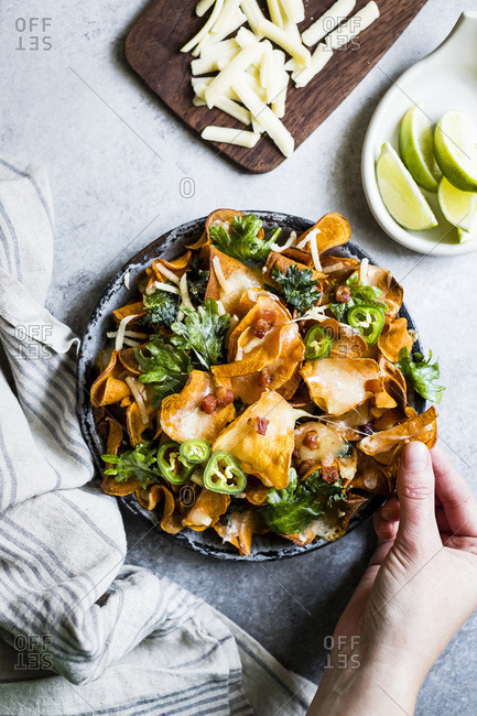 sweet potato chips with pancetta, kale, shredded apples, and a sprinkle of smoked paprika