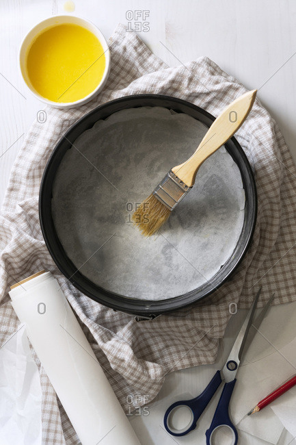 A springform pan brushed with melted butter and lined with baking paper.