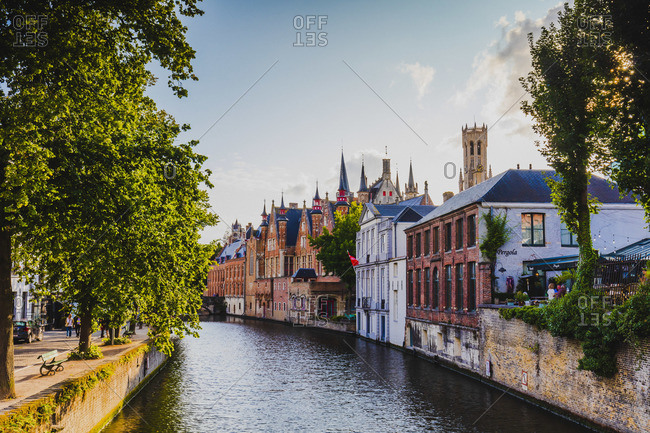 October 10, 2019: View of Bruges old town reflecting in the water canal, Belgium