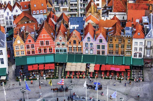 October 10, 2019: Belgium, West Flanders (Vlaanderen), Bruges (Brugge). Elevated view of the medieval guild houses and restaurants on Markt square