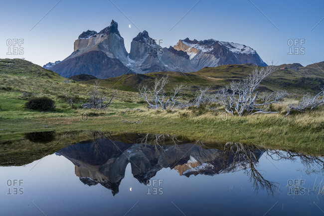Los Cuernos mountains reflecting in a puddle after sunset, Torres del Paine National Park, Magallanes Region, Chile