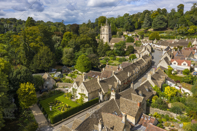 Aerial view of Castle Combe, Cotswolds, Gloucestershire, England, UK