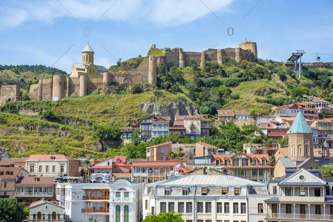 June 6, 2019: Narikala Fortress above historic buildings in old town, Tbilisi (Tiflis), Georgia.