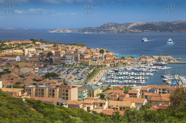 May 29, 2019: Italy, Sardinia, Sassari Province, Palau, View city and Marina, with Maddalena archipelago in the distance