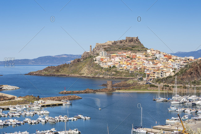 Italy, Sardinia, Sassari Province, Castelsardo, View over marina towards the ancient Castle of the Doria